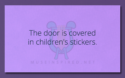 What's the Story – The door is covered in children's stickers.