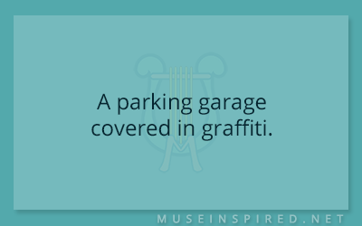 Siring Settings – A parking garage covered in graffiti.